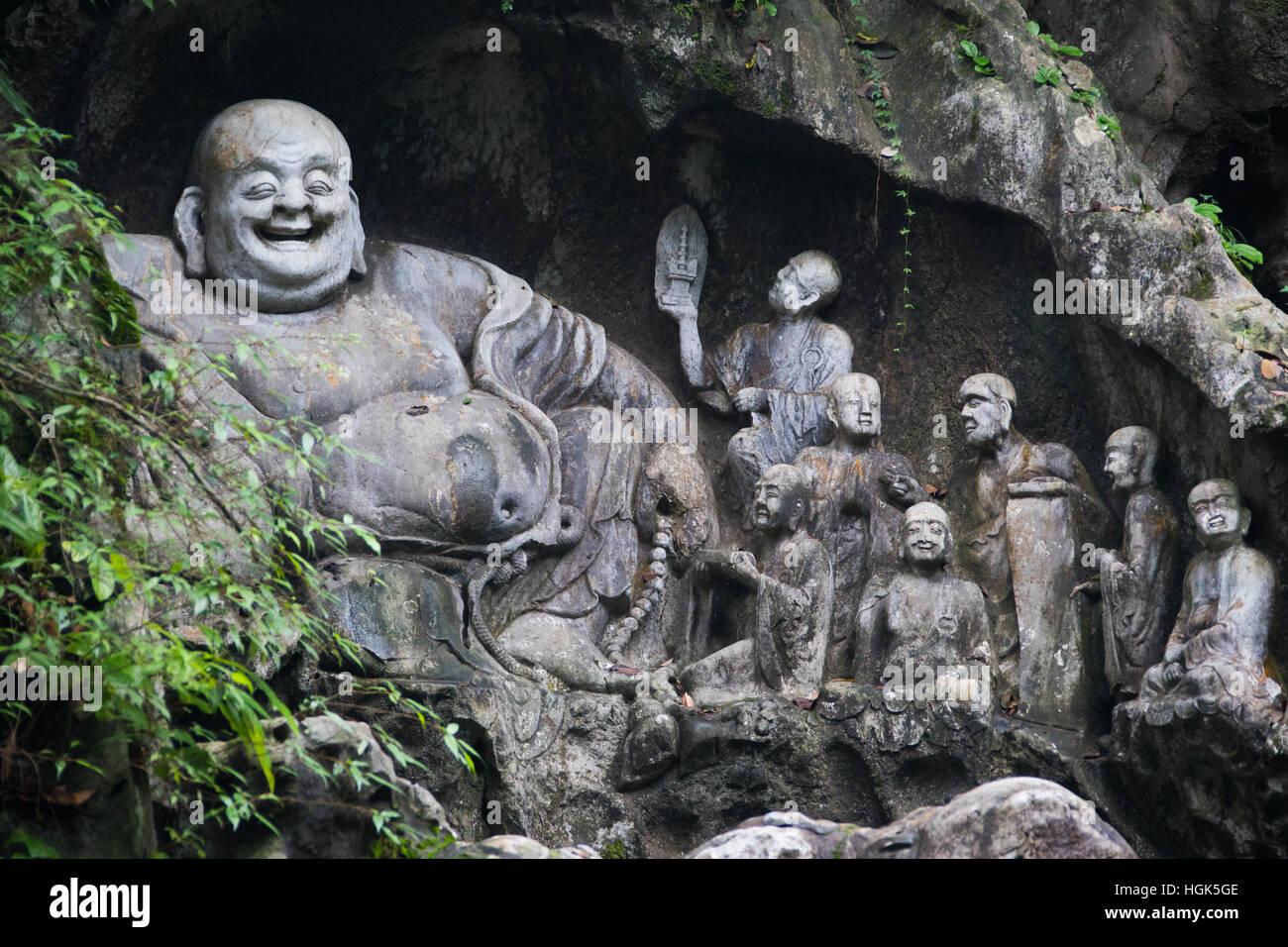 Ridere Buddha, Feilai Feng grotte calcaree Ling Yin tempio Hangzhou Cina Immagini Stock