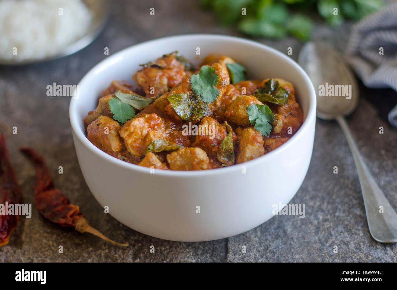 Indian di maiale al curry con riso basmati Immagini Stock