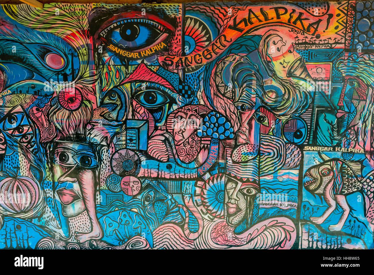 Street Art, colorati graffiti con gli occhi e con facce, Yogyakarta, Java, Indonesia Immagini Stock