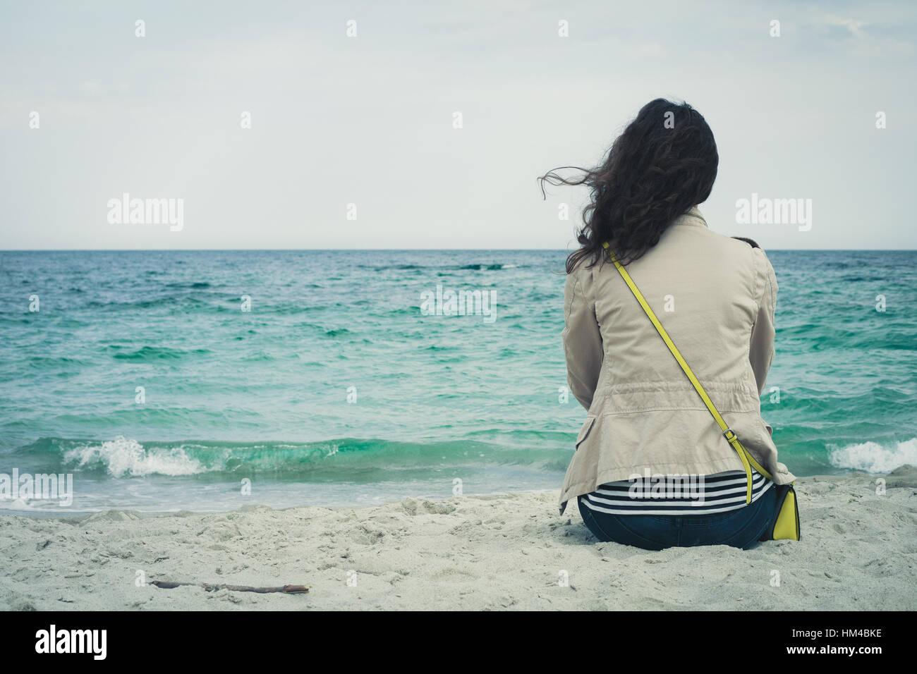 Capelli ricci e spiaggia