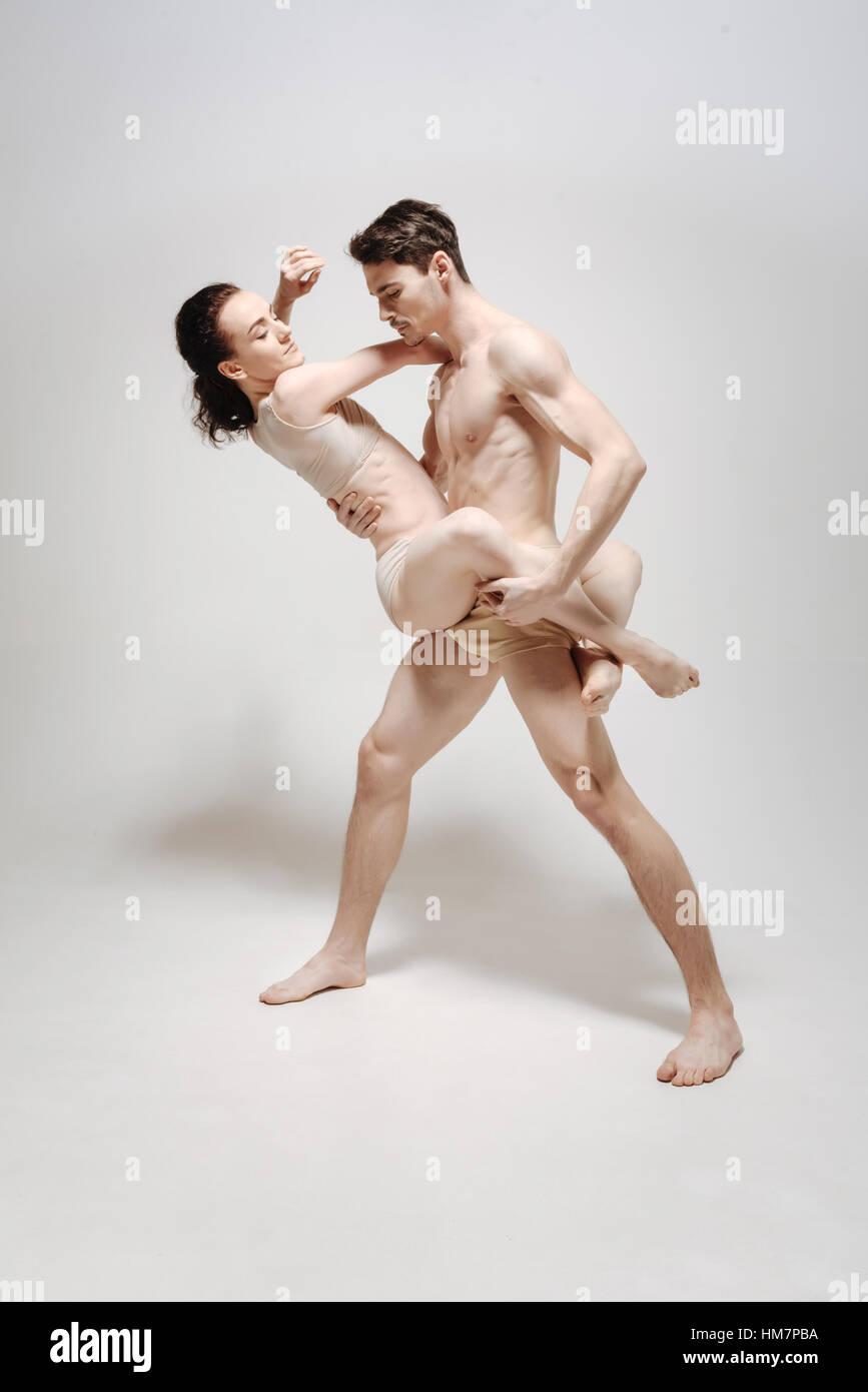 Atleti avanzati eseguendo isolato in uno sfondo bianco Immagini Stock