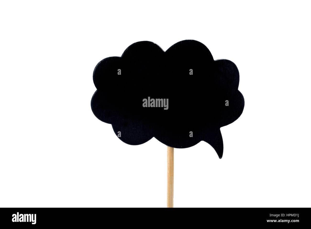Un vuoto nero cartello a forma di bolla fuzzy, attaccato ad un bastone, contro uno sfondo bianco Immagini Stock