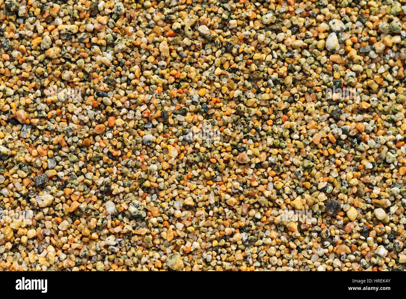Texture di piccole pietre,texture microcosmo, desktop, migliaia di colori, pietre Immagini Stock
