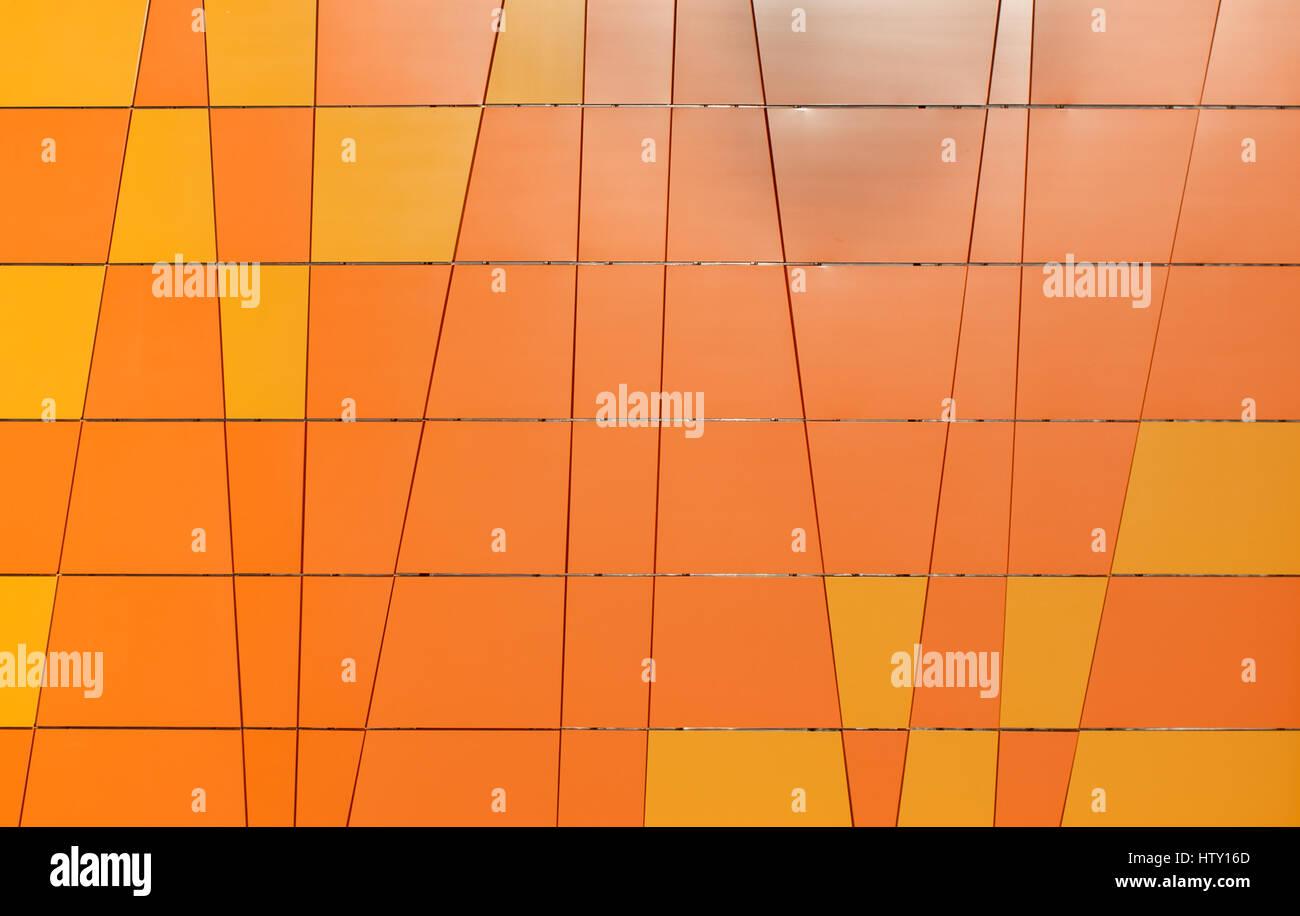 Geometrica sfondo arancione dalle piastrelle con forme differenti