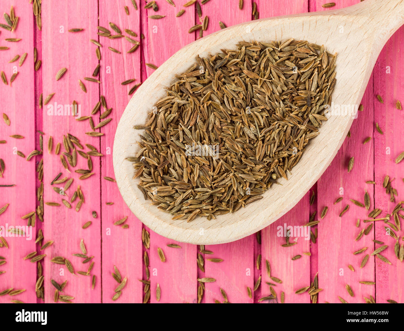 Cucchiaio di secche semi di cumino spice Immagini Stock