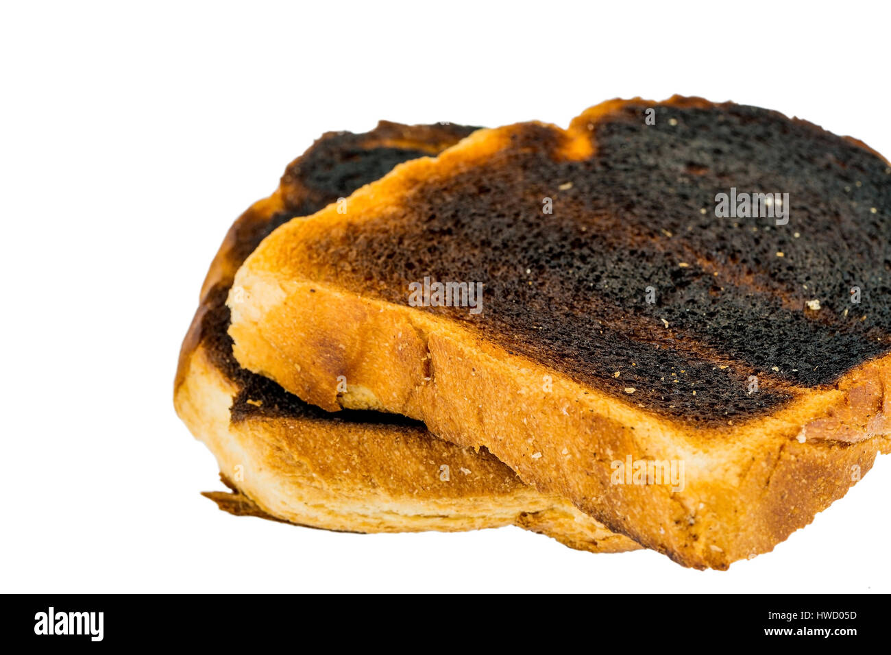 Tostare il pane è diventato con brindare burntly. Toast bruciato dischi, Toastbrot wurde beim toasten verbrannt. Verbrannte Toastscheiben Foto Stock