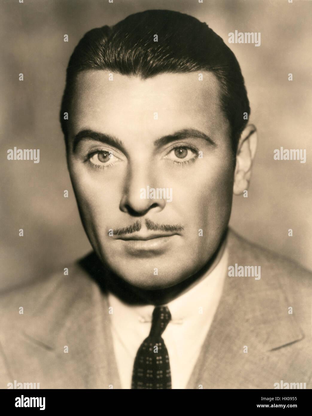 George Brent, testa e spalle pubblicità ritratto, 1940 Immagini Stock