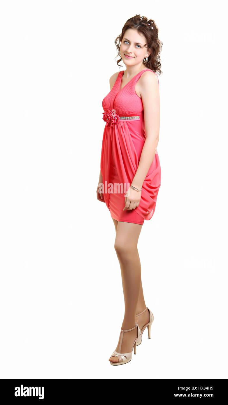 Un laureato della scuola indossava abito da sera color corallo per la  scuola prom. Schoolgirl high school girl indossando coral abito da sera per  la PROM in ... 246138737ea7