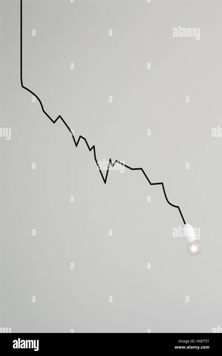 Una lampade del cavo elettrico disegna un grafico di caduta Immagini Stock