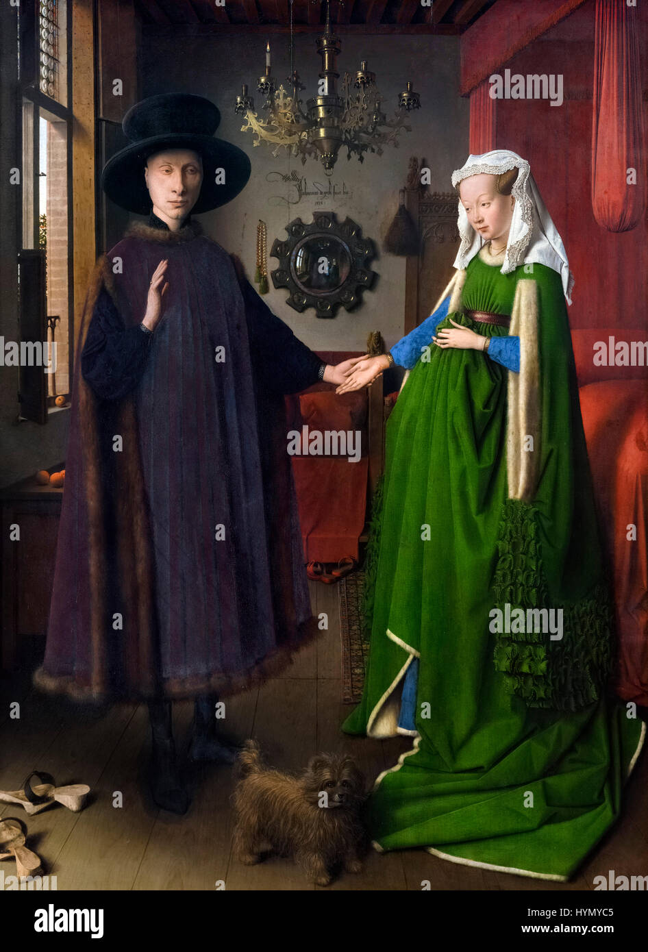 Ritratto di Giovanni Arnolfini e sua moglie (il ritratto Arnolfini) di Jan Van Eyck (c.1390-1441), olio su pannello Immagini Stock