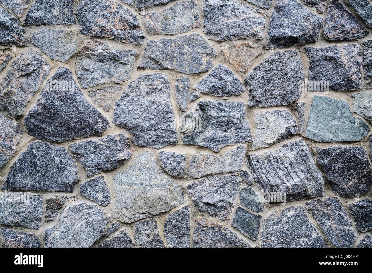 La parete di roccia texture perfetta configurazione di sfondo Foto Stock