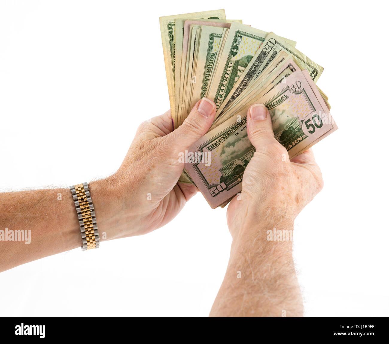 Tenendo la ventola del denaro - cinquanta e venti US Dollar Bills banconote Immagini Stock