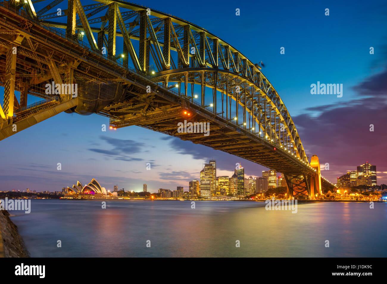 Sydney. Cityscape immagine di Sydney, Australia con Harbour Bridge al tramonto. Immagini Stock