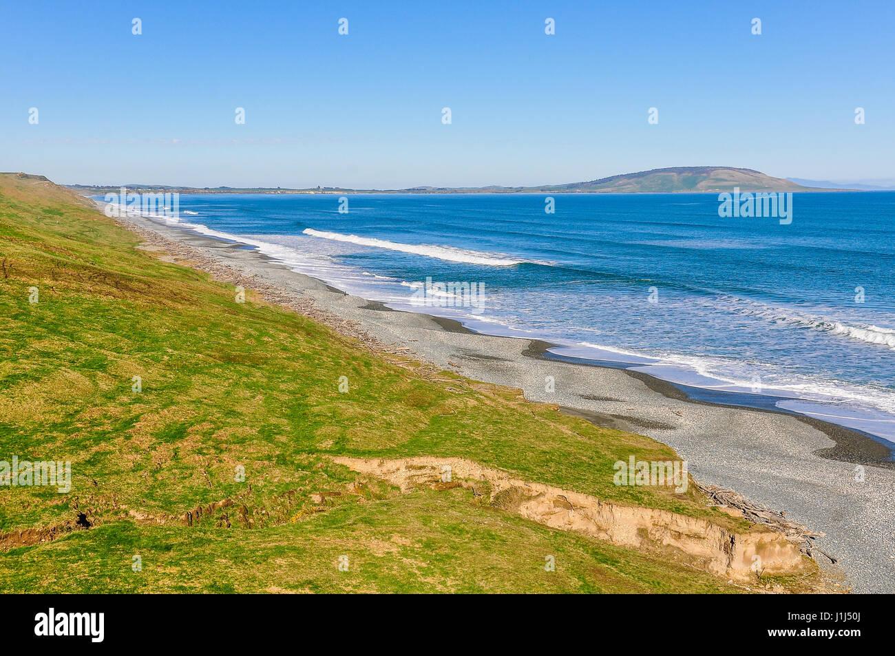 Ruvido paesaggio costiero nel sud del percorso panoramico, Nuova Zelanda Immagini Stock