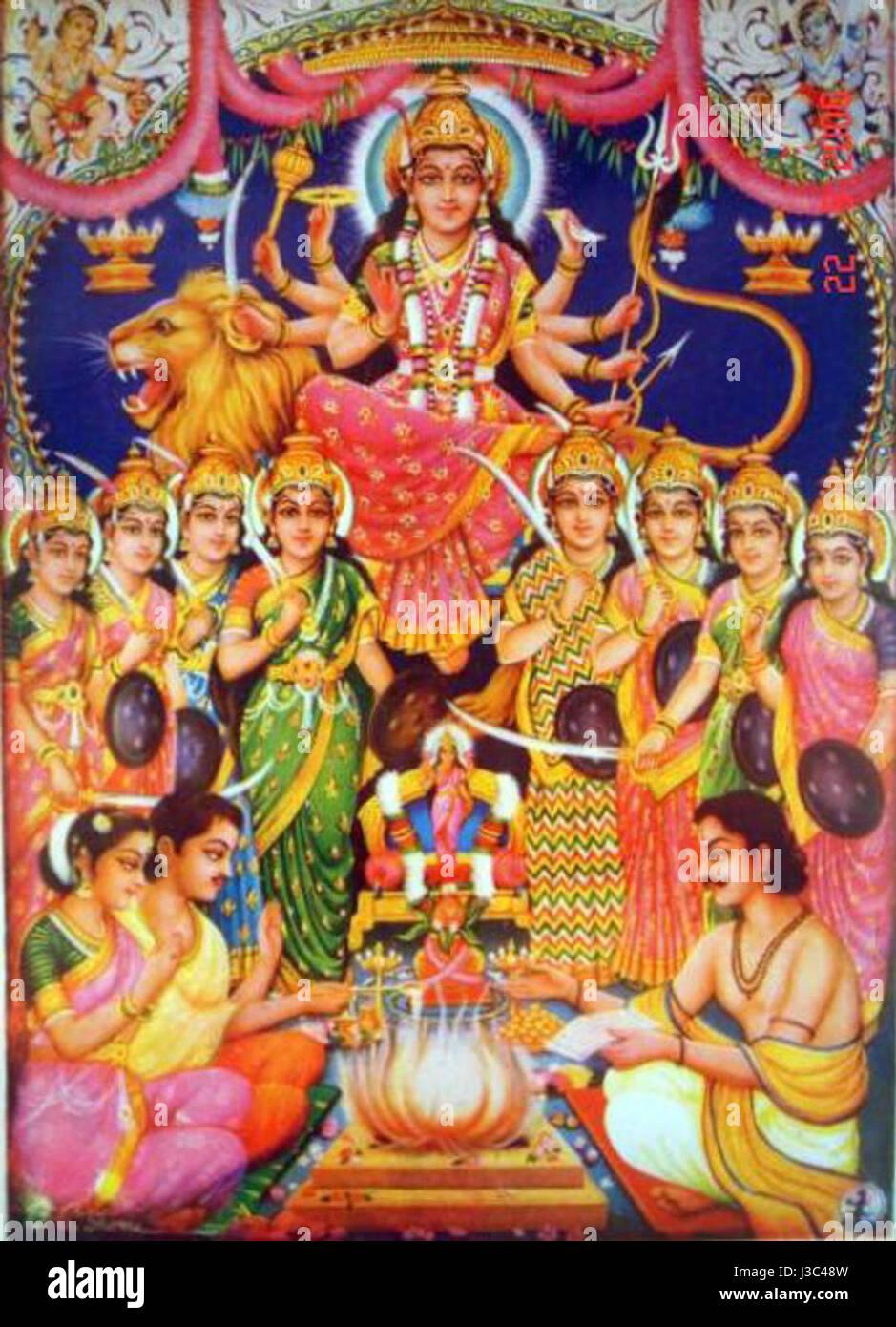 Durga presiede un fuoco vedico sacrificio (bazaar arte, c.1950's) Immagini Stock
