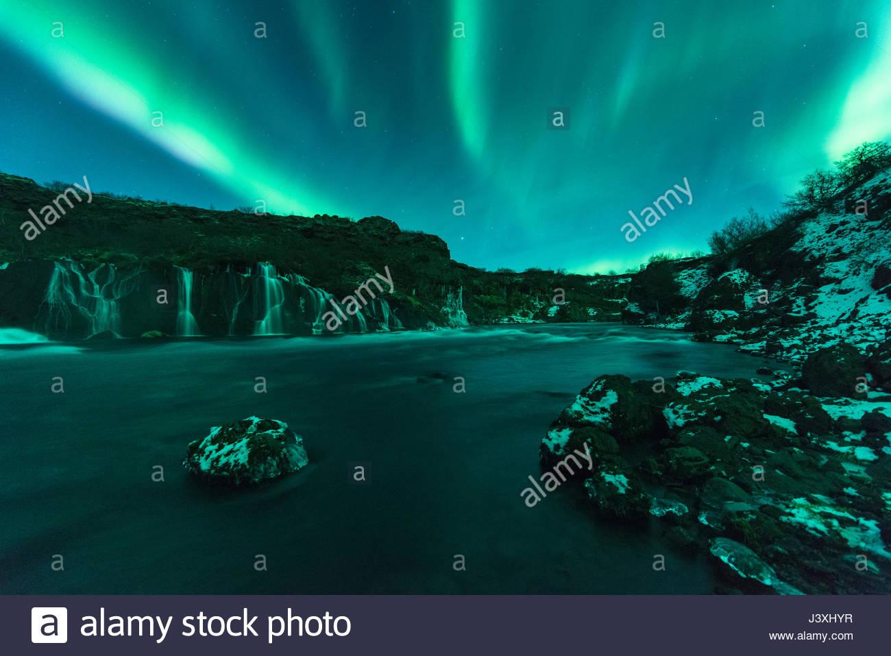 Luci del nord, Hraunfossar, Islanda Immagini Stock
