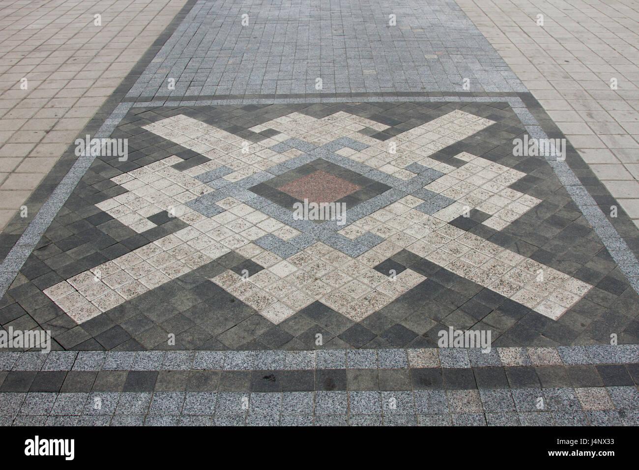 Piastrelle bianche e nere e il marciapiede mosaico di piastrelle