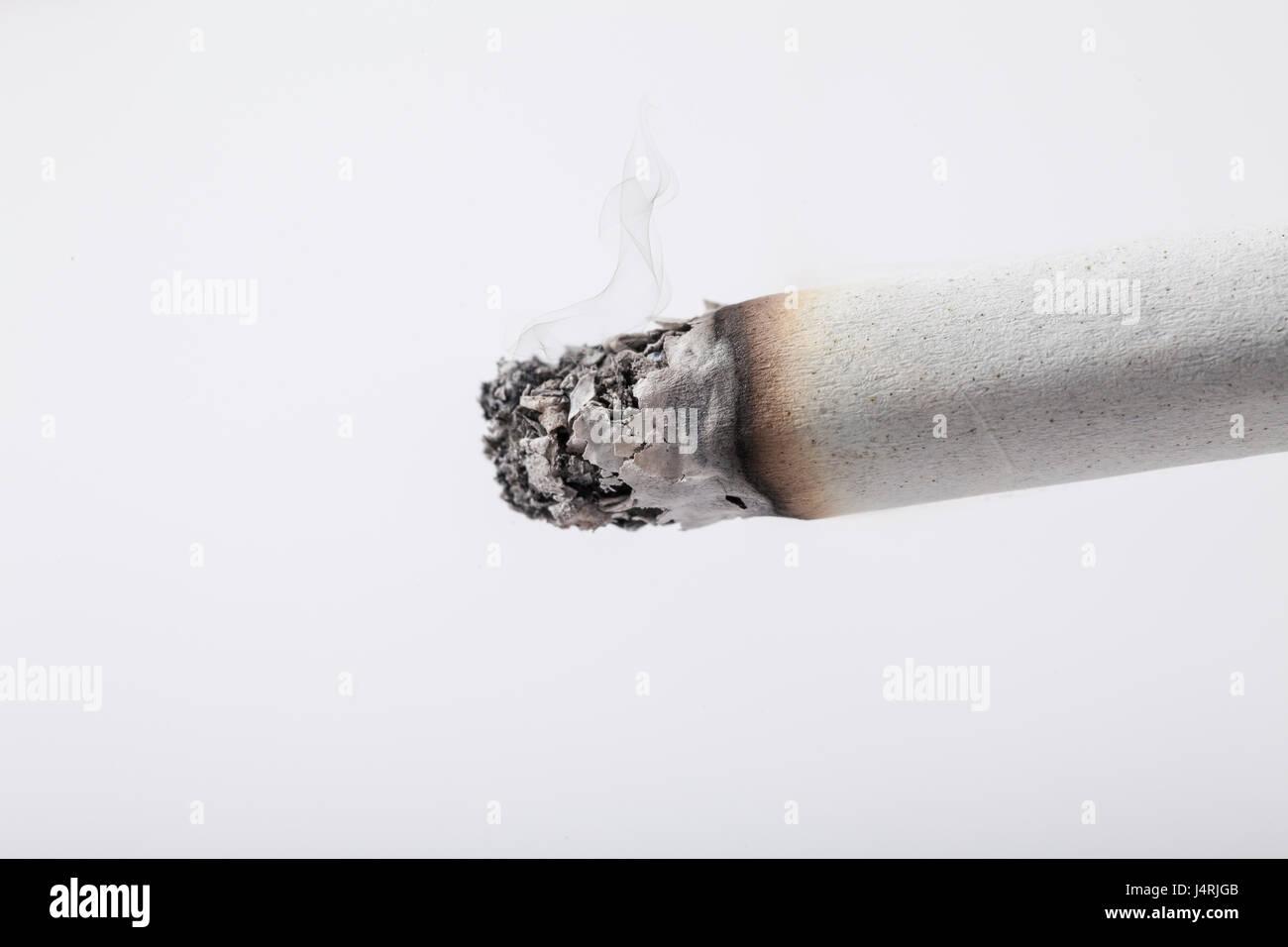 Sigaretta accesa Immagini Stock