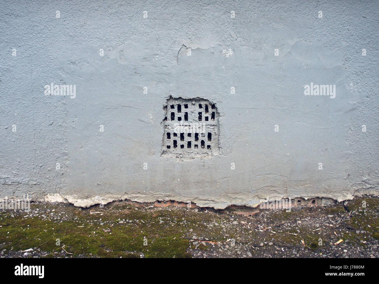 Fori tecnologico parete grigio chiaro parete di calcestruzzo foto