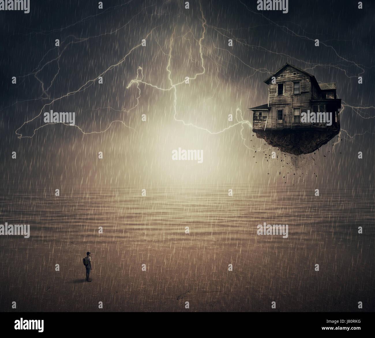 Backround surreale di un uomo in piedi sotto la pioggia, di fronte a una casa di volo strappato dal suolo, vicino Immagini Stock