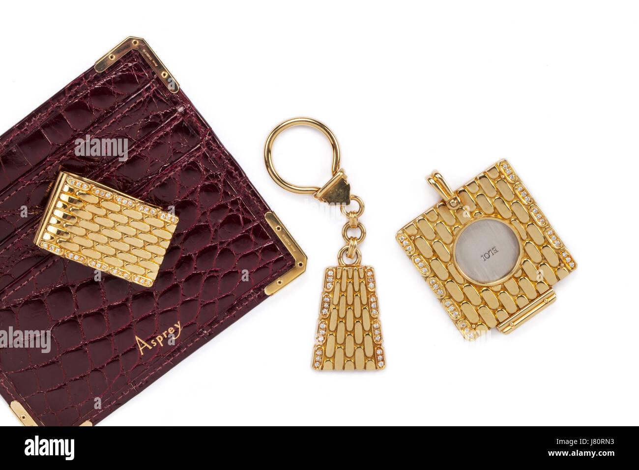 Asprey matching 18ct oro e diamante anello chiave, denaro clip, coltello da caccia e card wallet. Immagini Stock