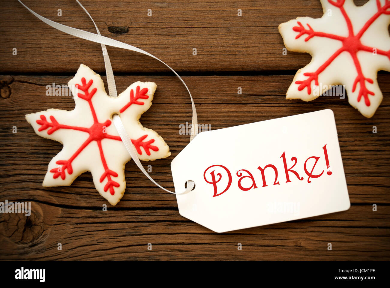 La Parola Natale Significa.Rosso E Bianco Stella Di Natale I Biscotti Con La Parola Tedesca Danke Che Significa Grazie Foto Stock Alamy