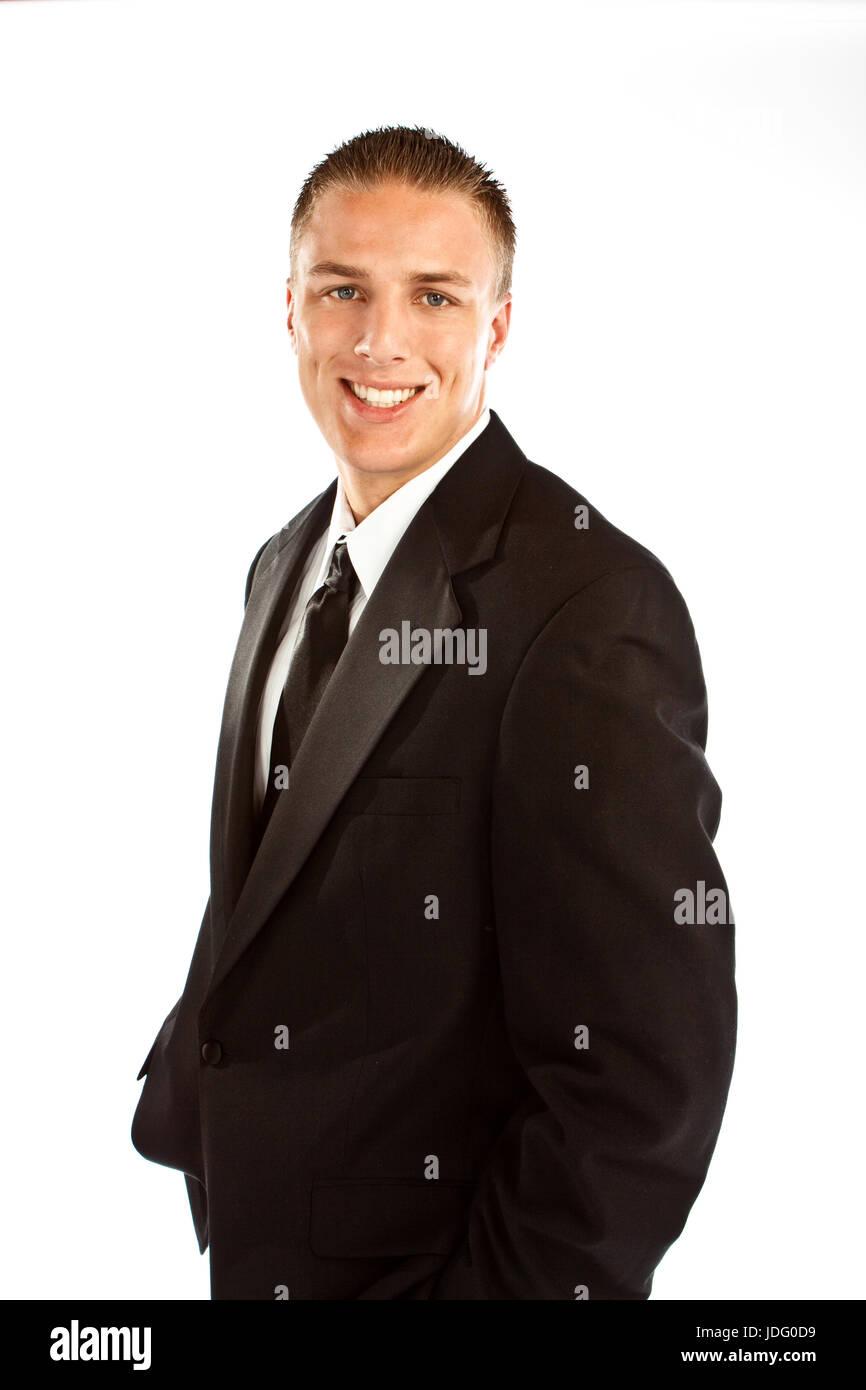 Ben vestito uomo isolato su bianco. Immagini Stock