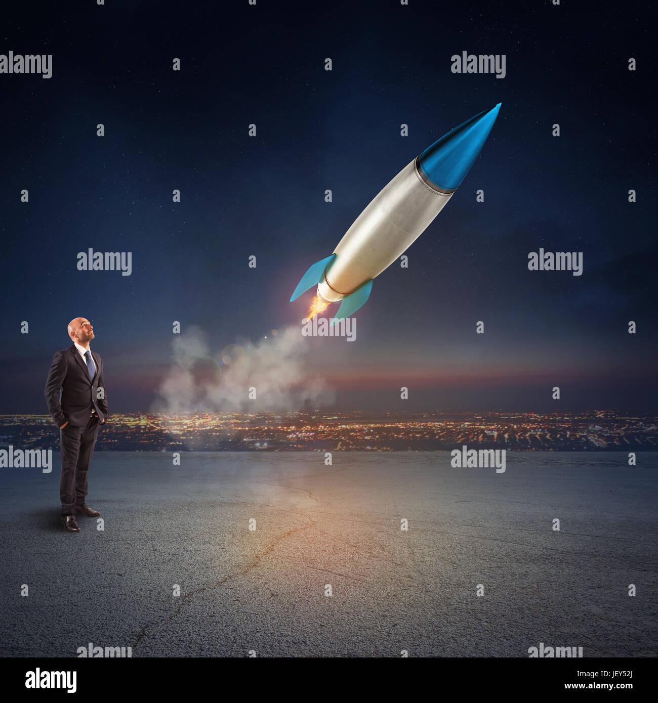 Imprenditore sembra iniziare un missile. Concetto di azienda e di avvio di nuovi affari. Il rendering 3D. Immagini Stock