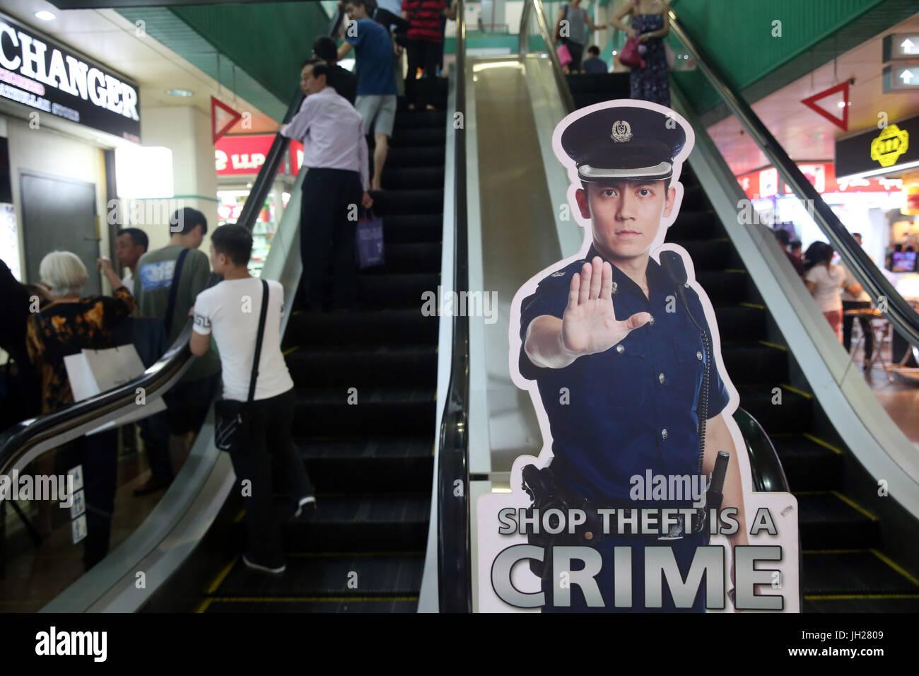 Acquista il furto è un segno della criminalità. Singapore. Immagini Stock