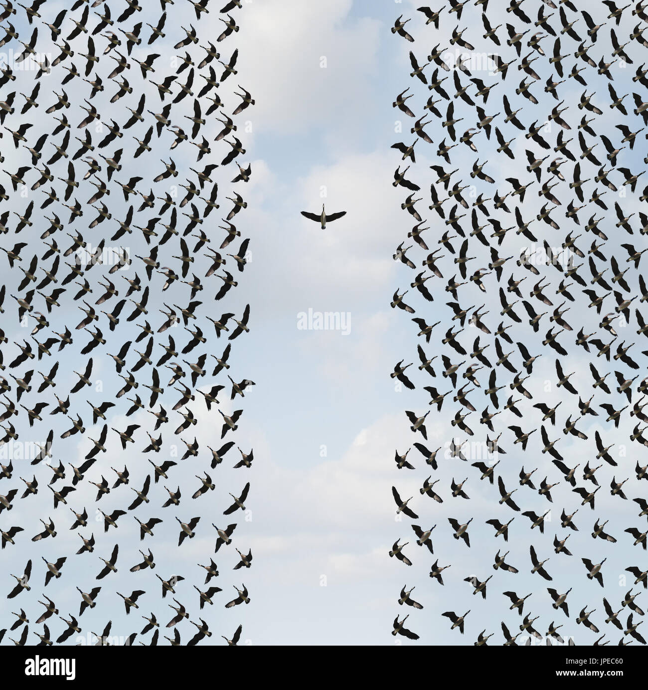Concetto di individualismo e individualità di simbolo o di pensatore indipendente idea e il nuovo concetto di leadership o coraggio individuale come un gruppo di uccelli. Immagini Stock