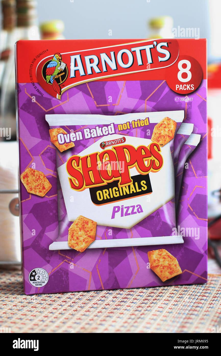 Una scatola di Arnott's cotta al forno originali forme Pizza cracker Immagini Stock
