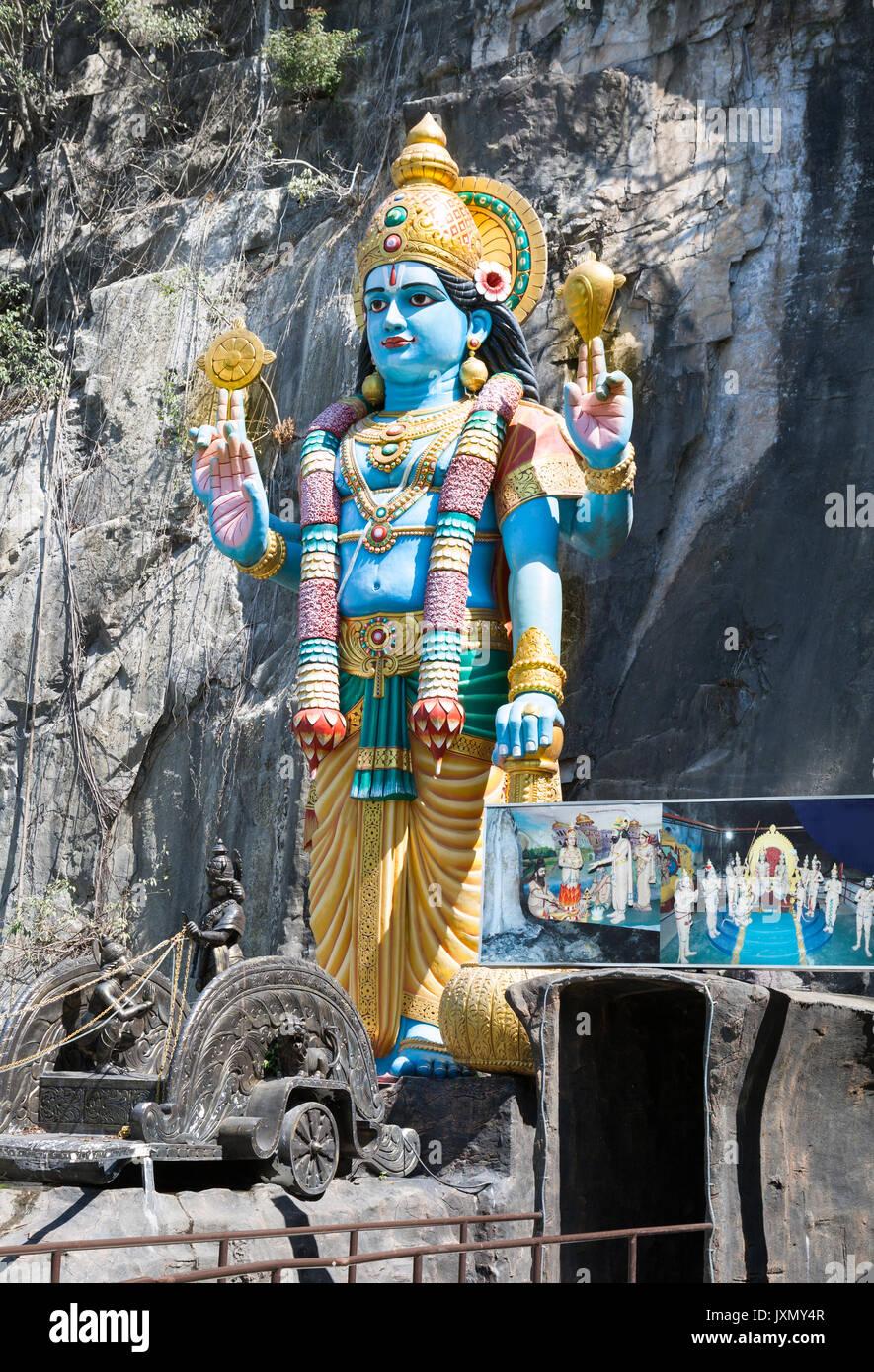Statua di Krishna in ingresso alla grotta di Ramayana, Grotte Batu, Gombak Selangor, Malaysia Immagini Stock