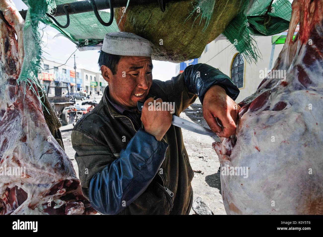 I Musulmani cinesi, il Hui minoranza etnica. Macellaio in Xinning. Cina Immagini Stock