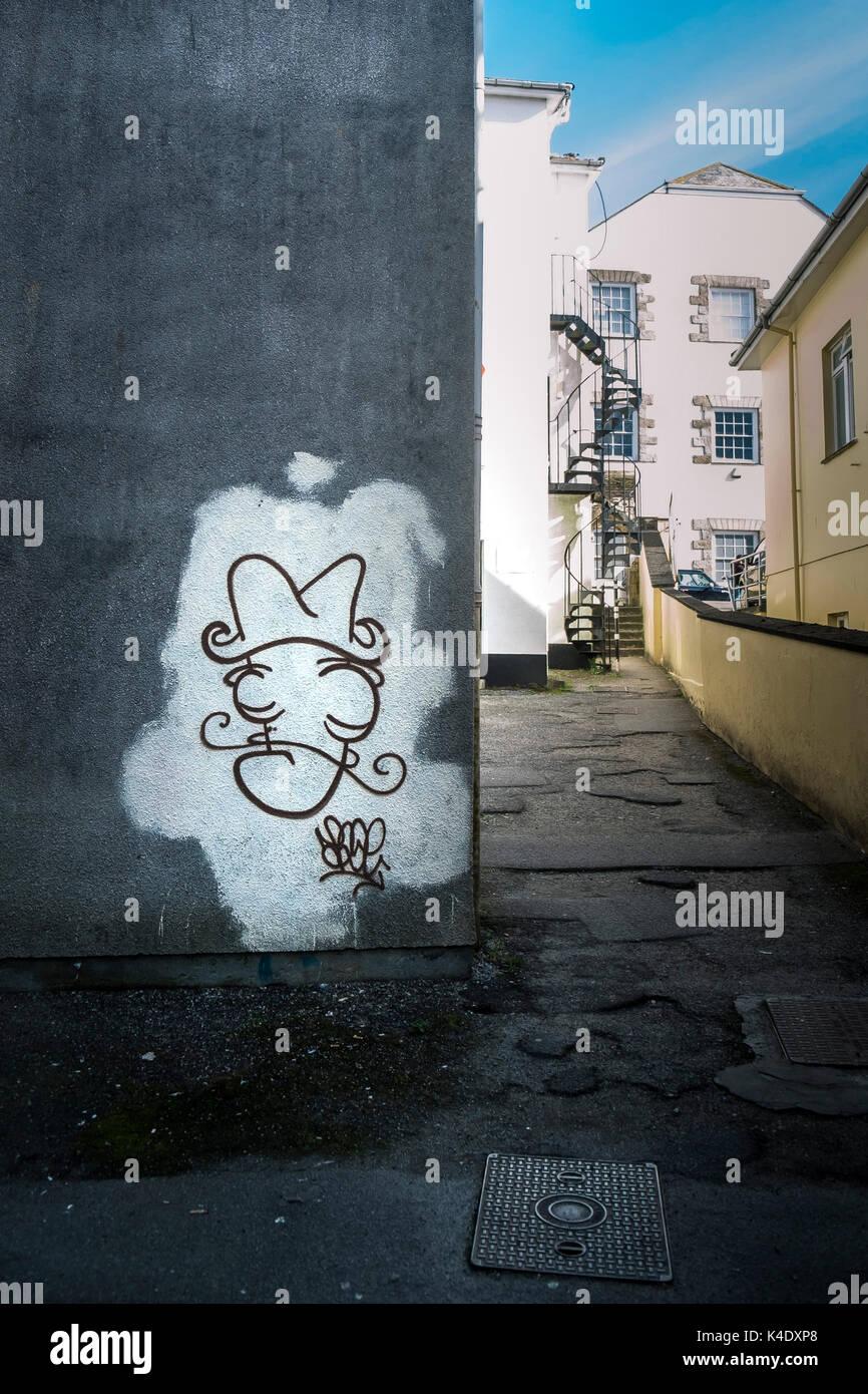 Graffiti - graffiti spruzzato su un muro nel centro di truro, Cornwall. Immagini Stock