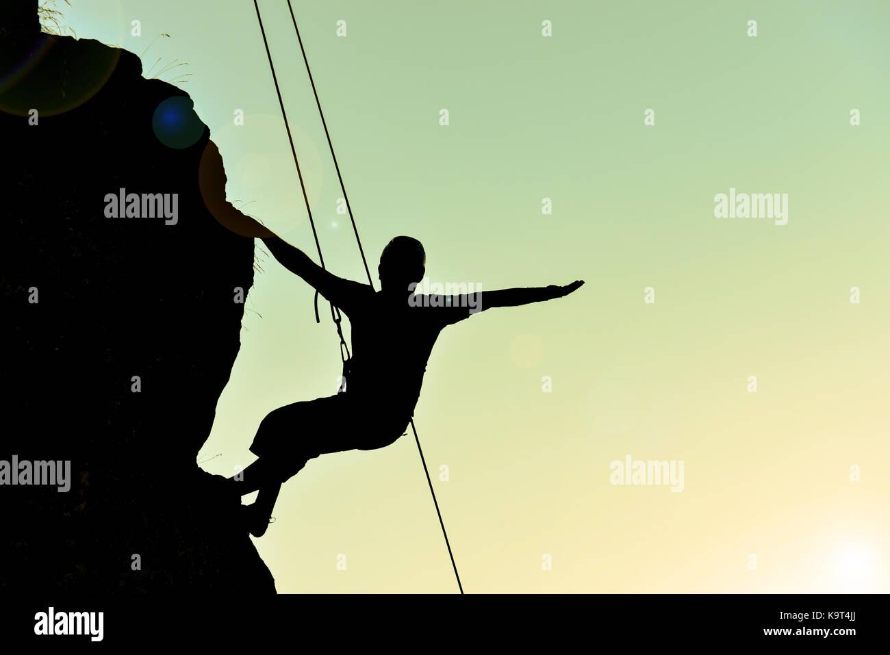 Cliff lo scalatore silhouette Immagini Stock