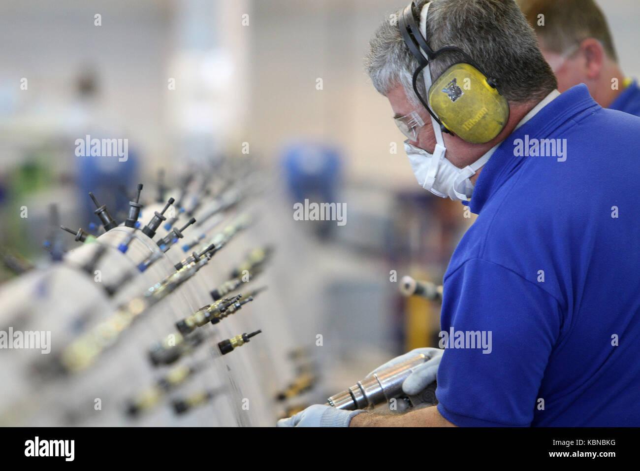 Operai nel settore manifatturiero Immagini Stock
