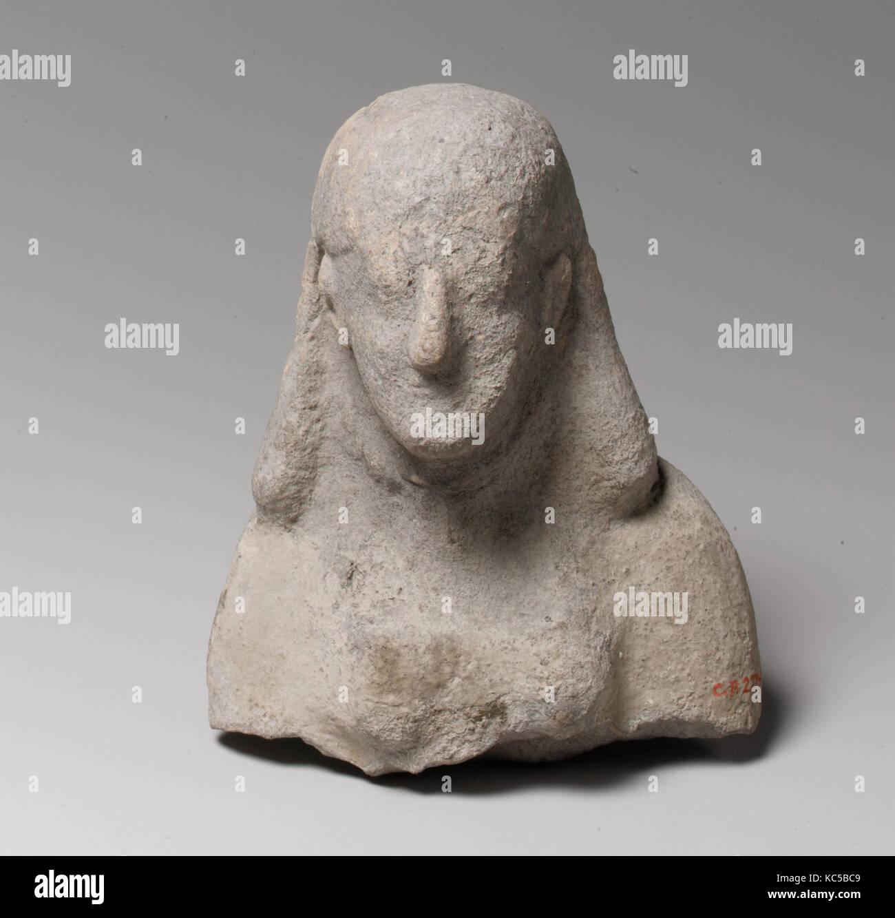 La testa e la parte superiore del corpo di una statuetta femminile, dal VI secolo A.C. Immagini Stock