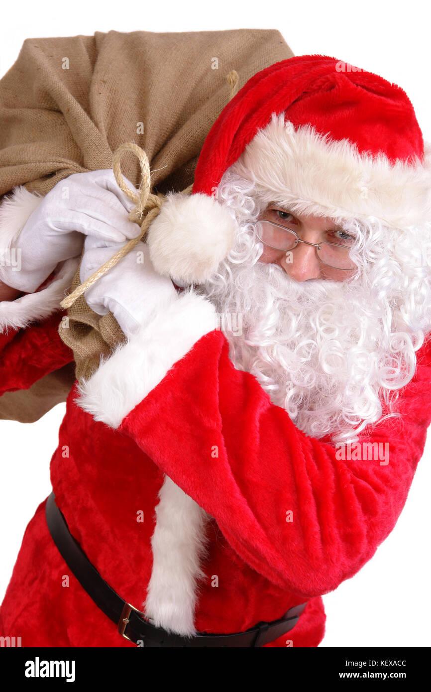 Regali Di Babbo Natale.Babbo Natale Che Porta Grande Sacco Sulle Spalle Pieno Di Regali Di Natale Foto Stock Alamy