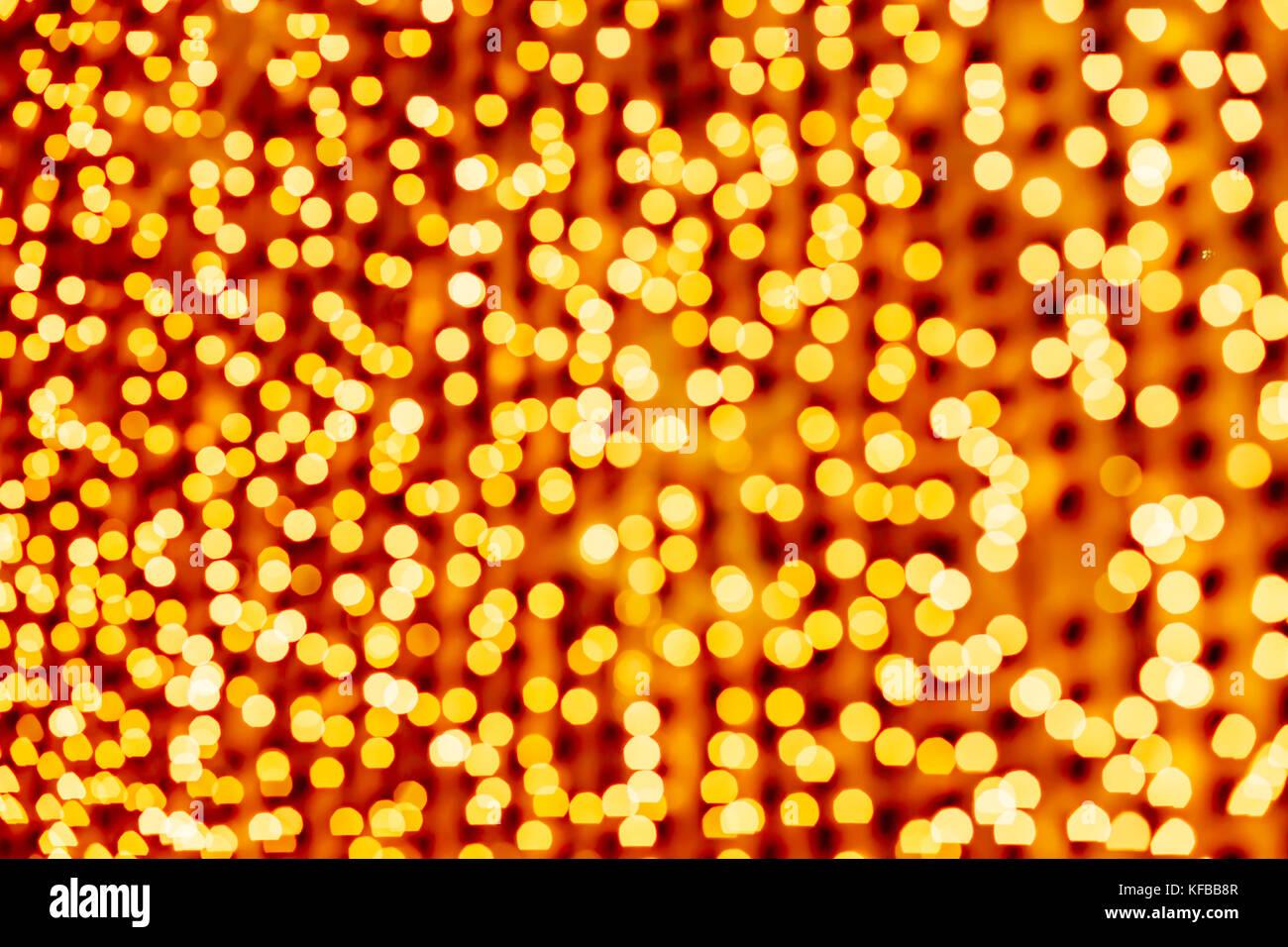 Giallo sfondo astratto. Bokeh di fondo. Sfondo di Natale e Capodanno. Immagini Stock