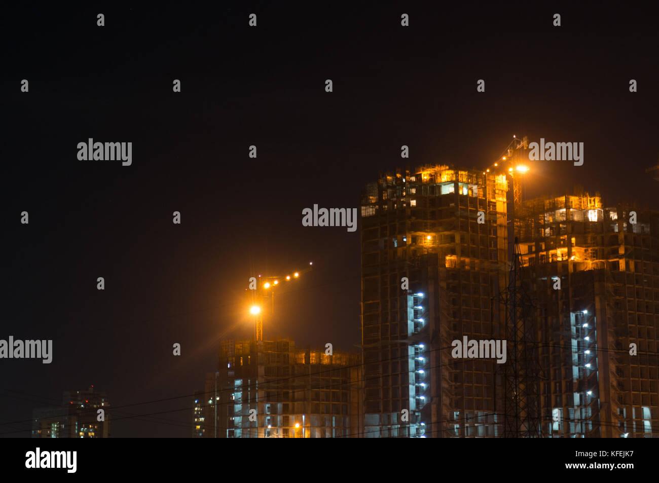 Gurgaon Noida raschino di cielo in costruzione di notte Immagini Stock