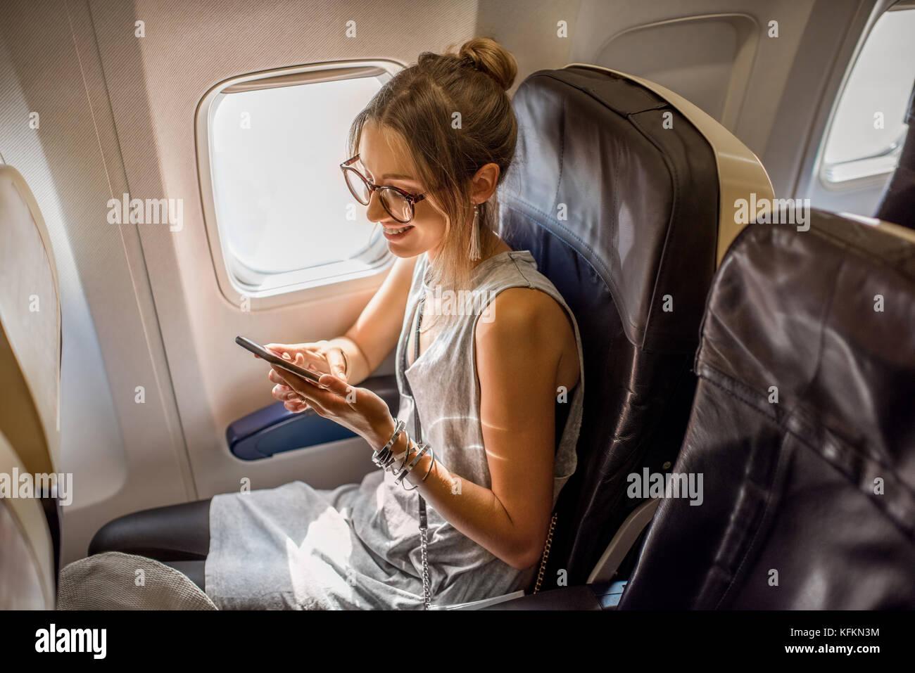 Donna in aereo Foto Stock