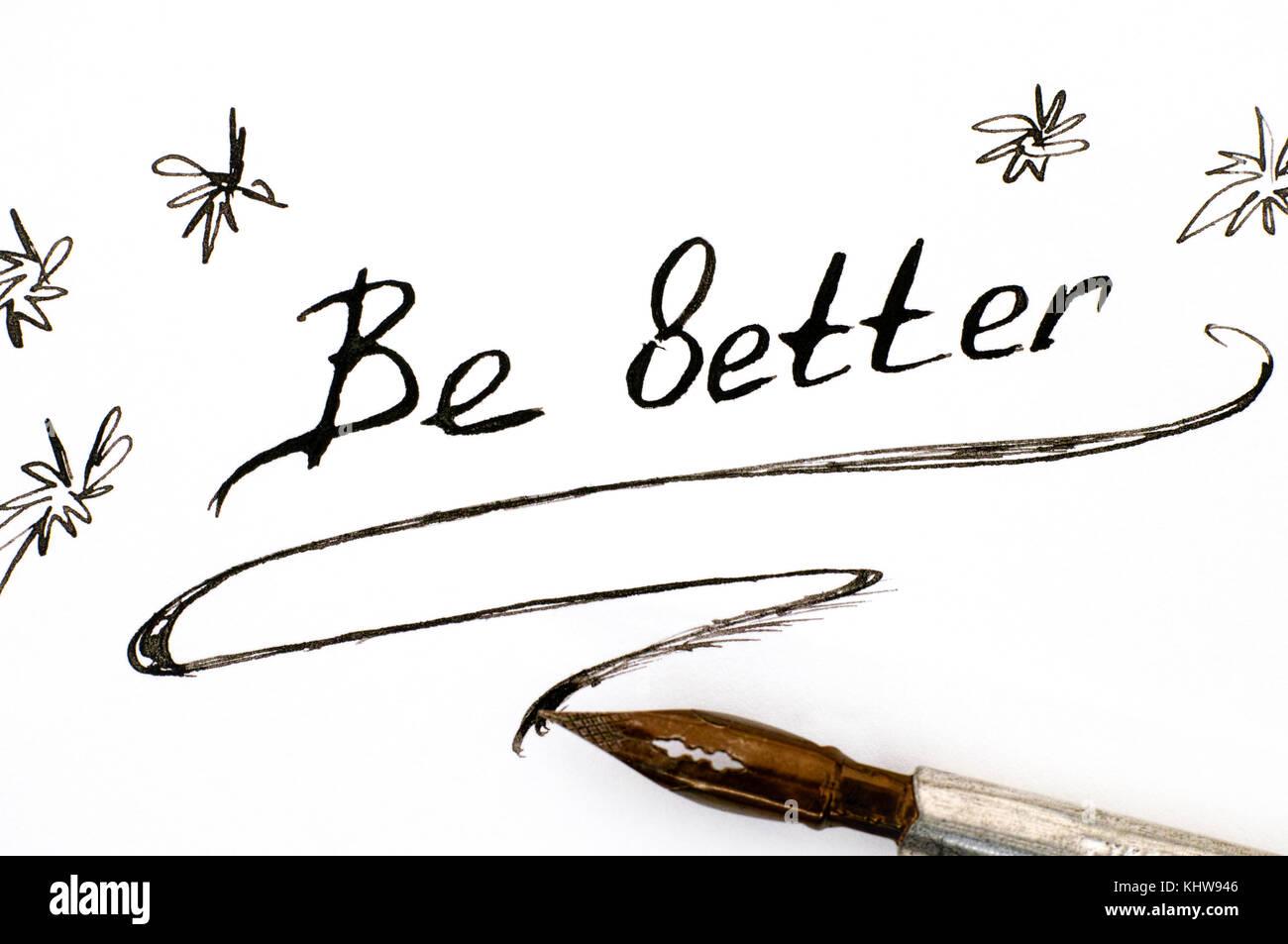 La frase della Scrittura essere meglio con penna. close-up. Immagini Stock