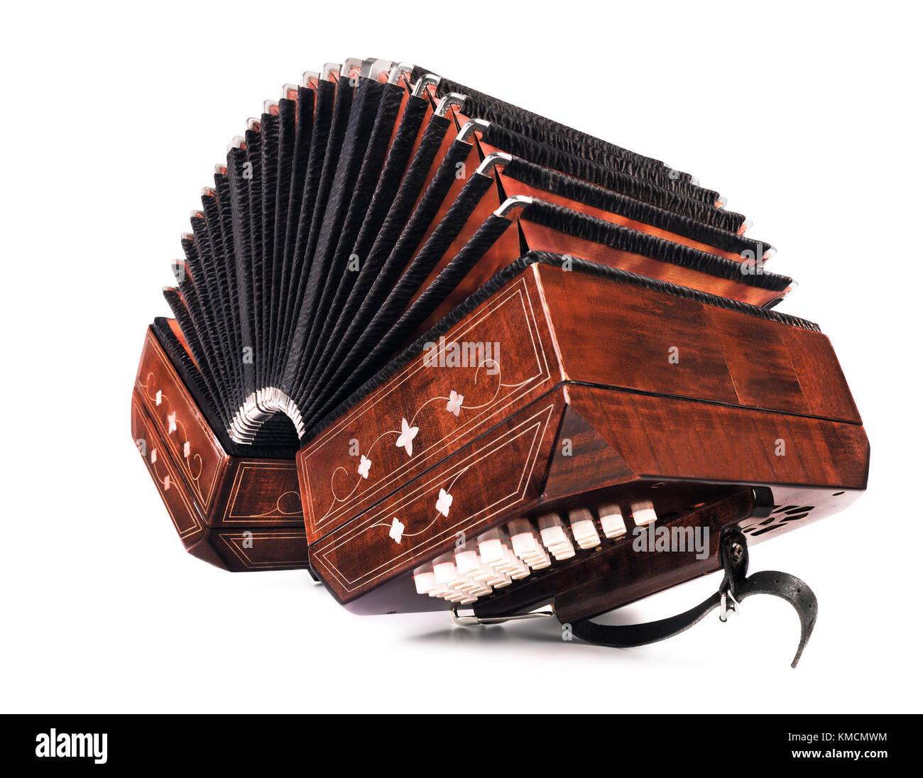 Il bandoneon, strumento di tango, tre quarti vista su sfondo bianco Immagini Stock