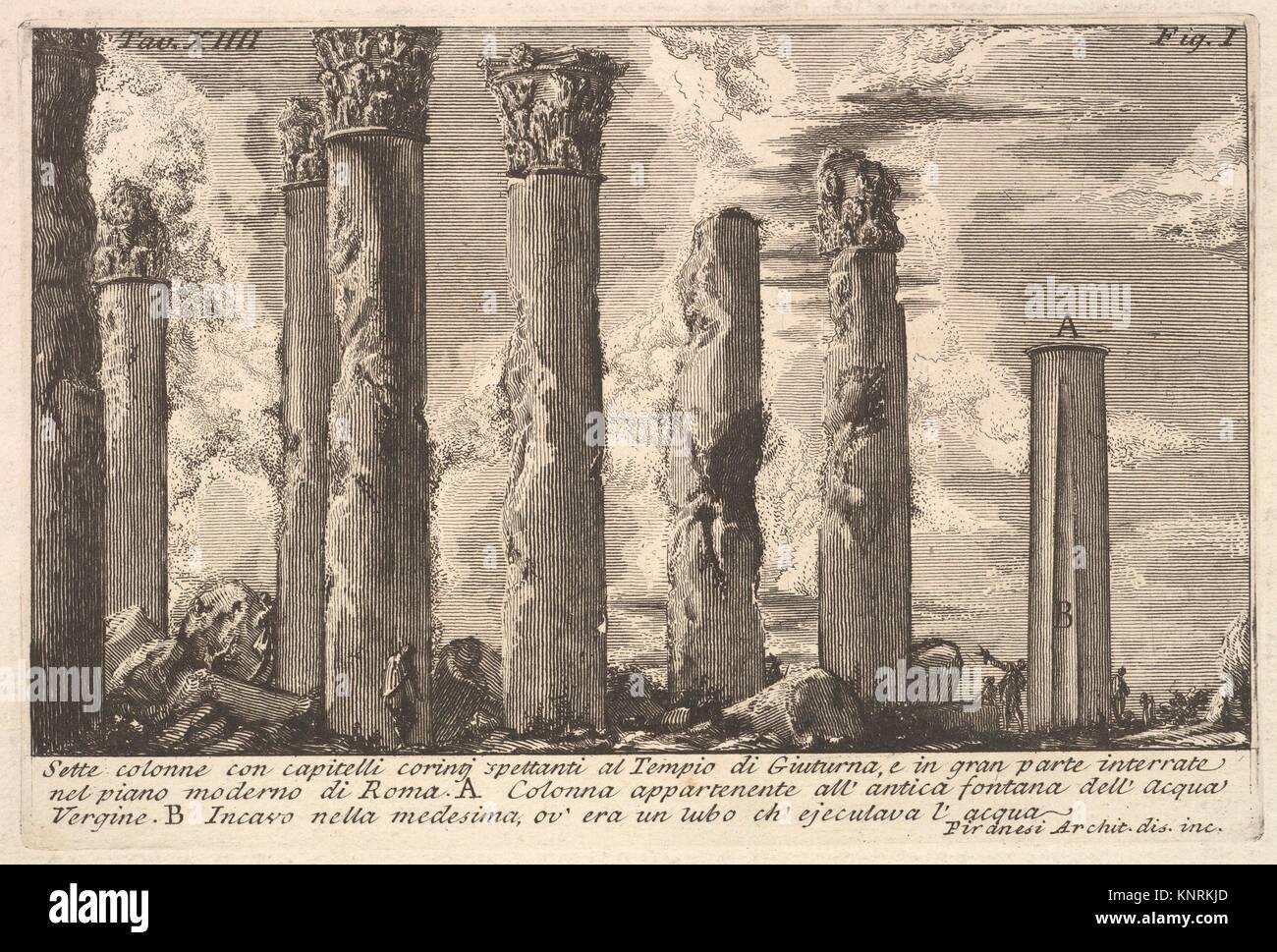 Sette colonne del tempio di Juturna con capitelli corinzi.(Sette colonne con capitelli Corinti spettanti al Tempio Immagini Stock