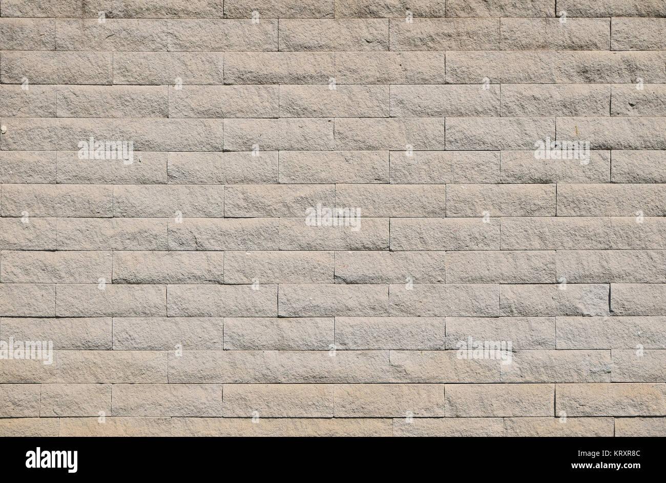 In mattoni beige piastrelle di pietra della parete texture di sfondo
