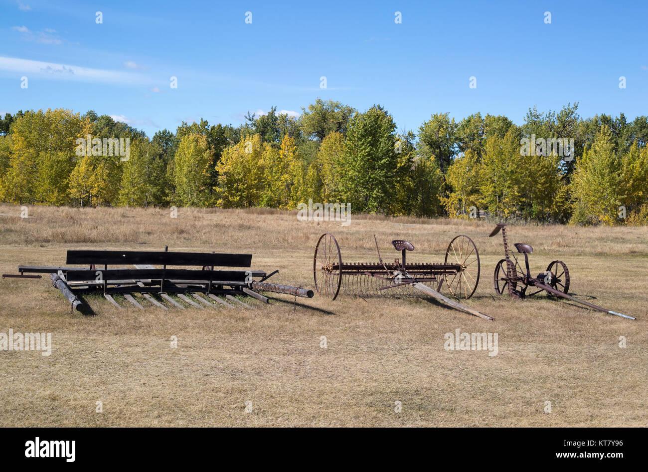 Macchinari agricoli in un campo presso il bar U Ranch National Historic Site Immagini Stock