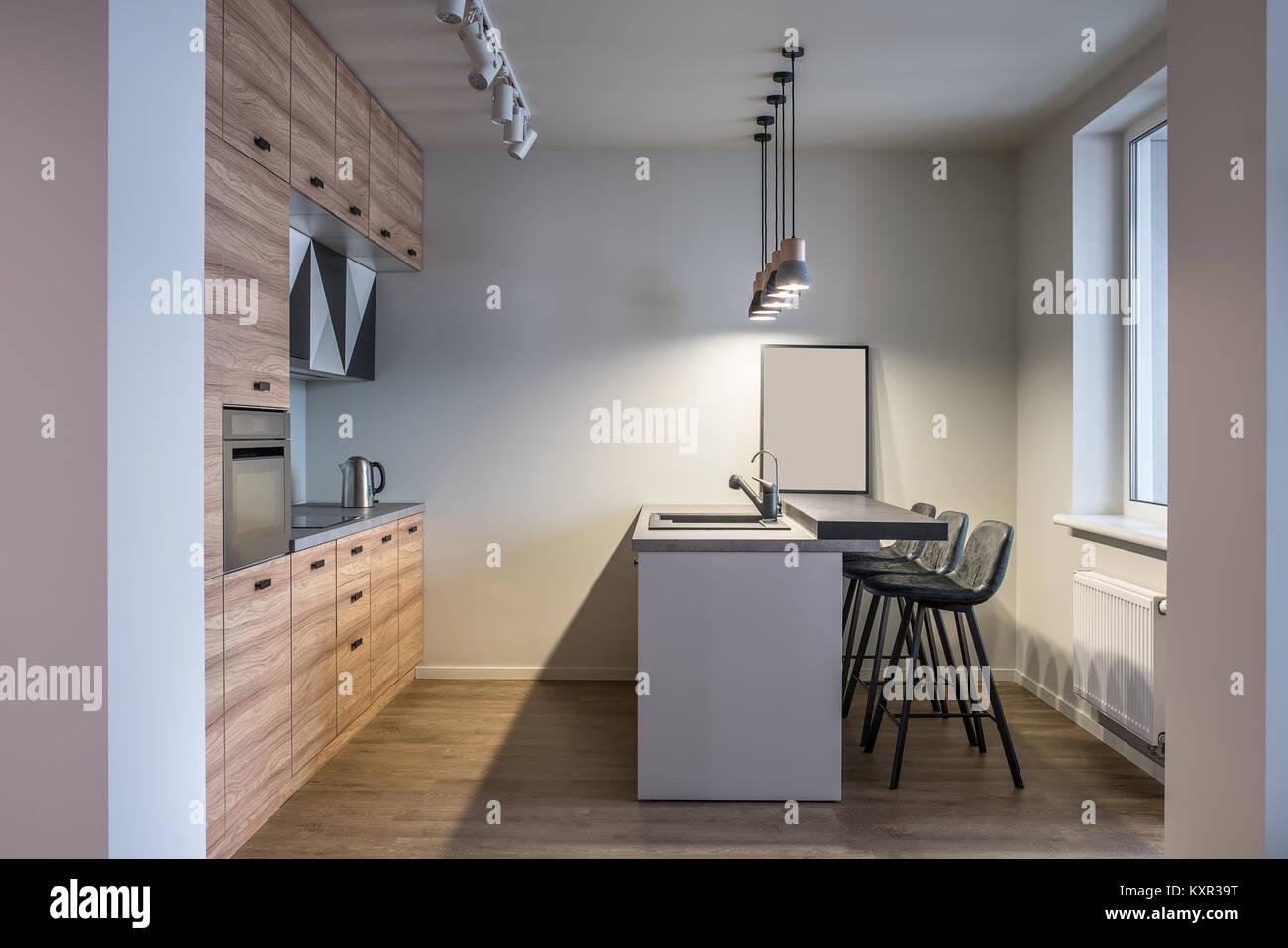 Cucina in stile moderno con pareti bianche e pavimenti in parquet ...