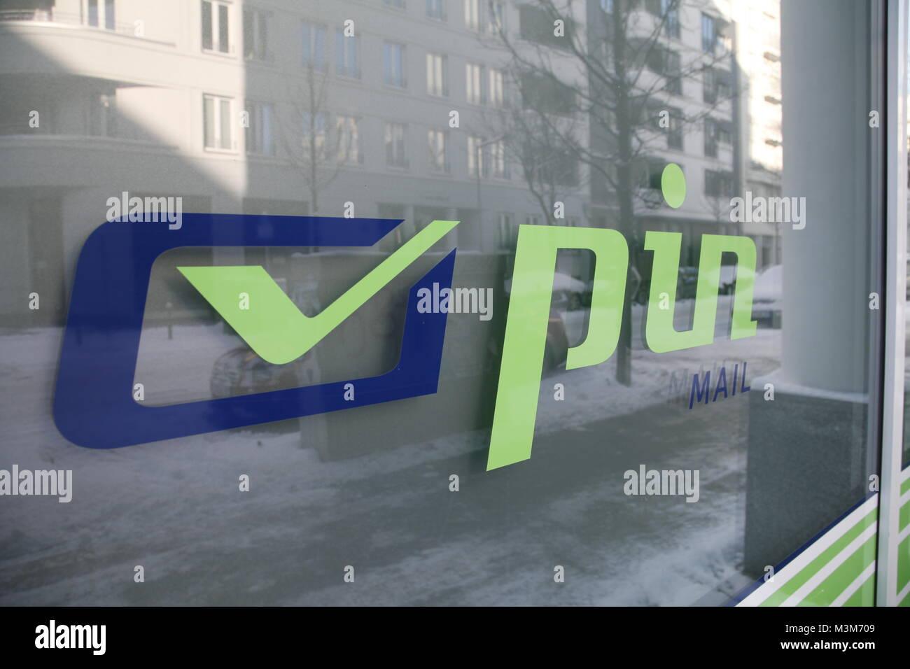 Pin logo ag auf schaufenster Foto Stock