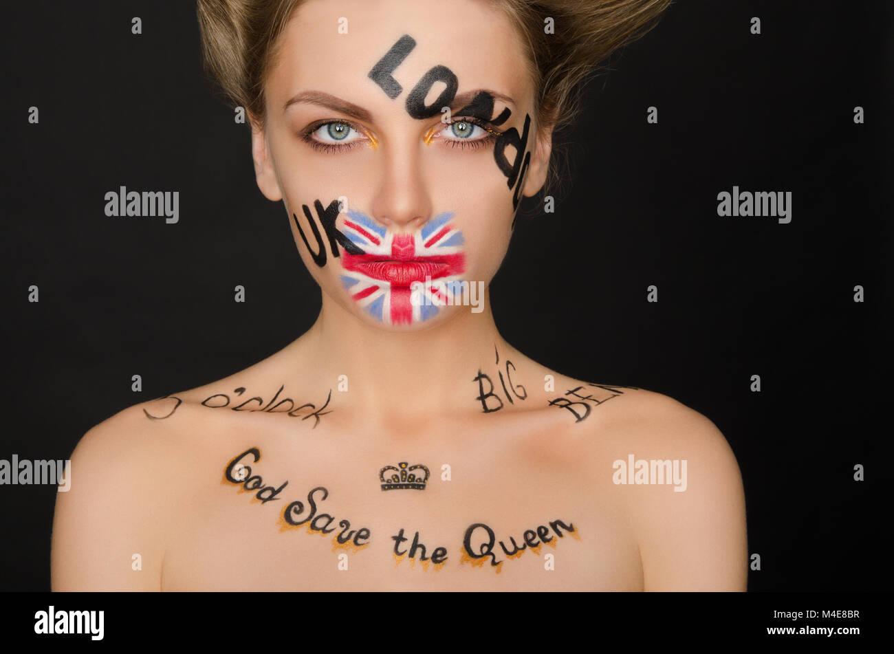 Ritratto di donna con simboli in inglese sul suo viso Immagini Stock