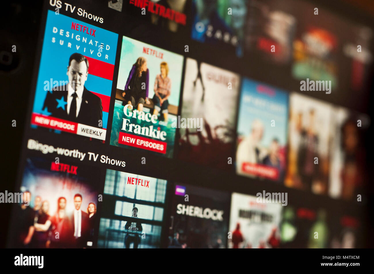Schermata di Netflix su un tablet Immagini Stock